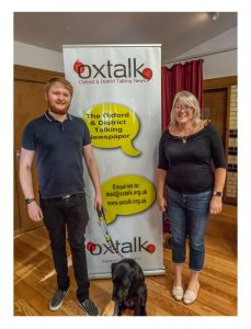 Photo of Nathan Tree with his guide dog Maisie and his Mum.